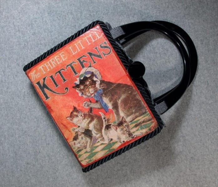 8.4.19-3-kittens-hand